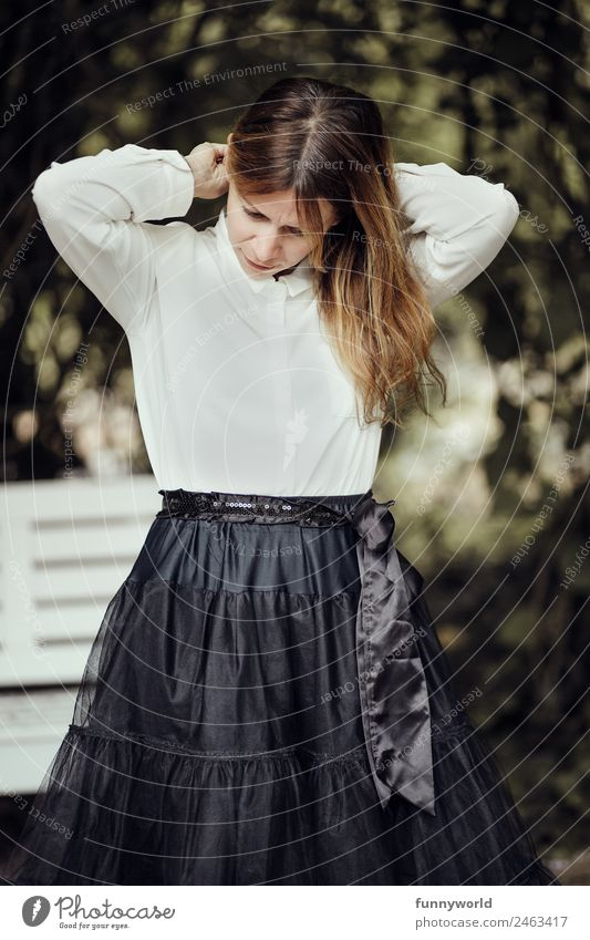 Woman with skirt and blouse grabs her hair Style Beautiful Feasts & Celebrations Human being Feminine Adults 1 30 - 45 years Fashion Clothing Skirt Blouse