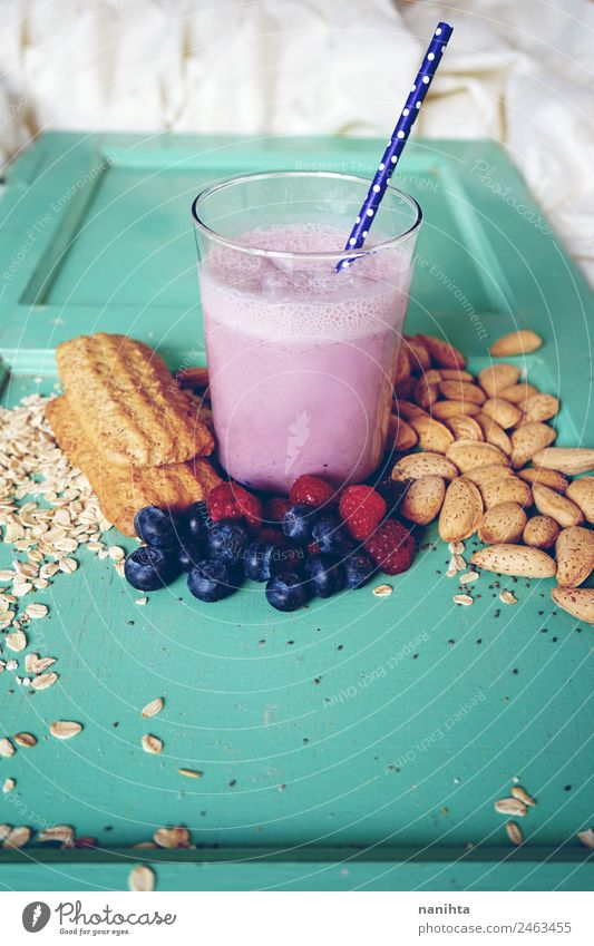 Breakfast with berries smoothie, berries and grains Food Fruit Grain Dough Baked goods Berries Almond Oats Oat flakes Cookie Nutrition Eating Organic produce