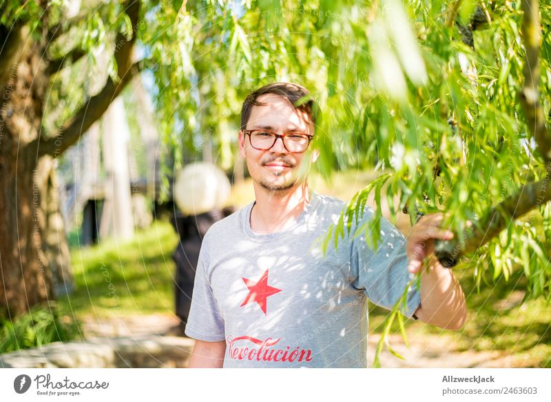 Nature Vacation & Travel Beautiful Green Young man Relaxation Travel photography Happy Contentment Bright Park Sit Smiling Happiness To enjoy Eyeglasses