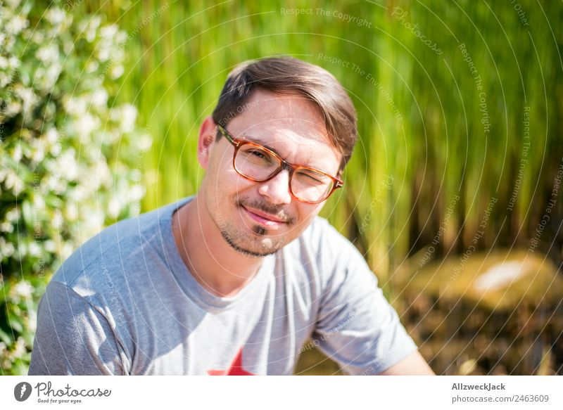 young man with glasses smiles in camera 1 Person Young man Portrait photograph Eyeglasses Person wearing glasses Smiling Congenial Happiness Friendliness Nature