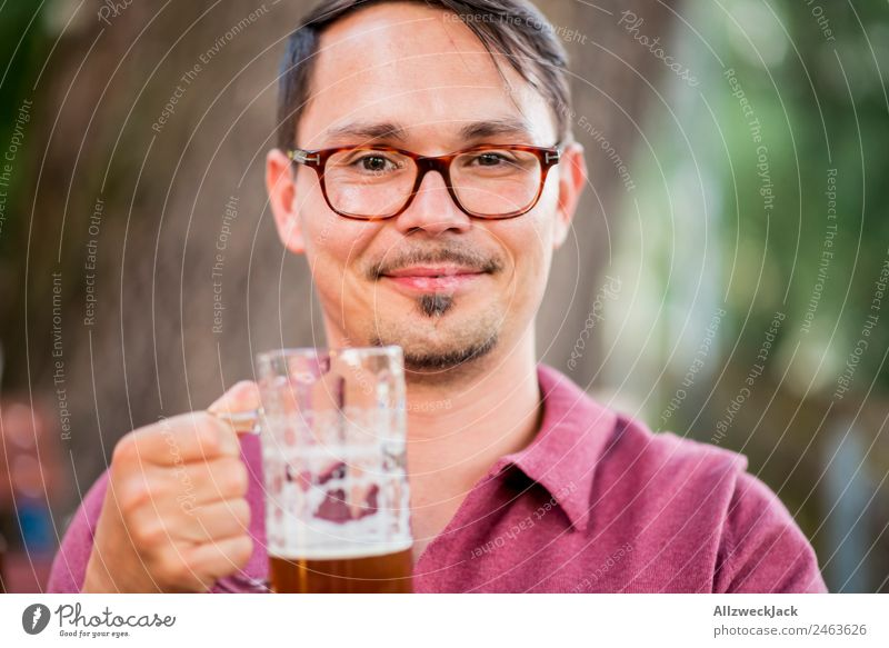 Portrait of a young man with a beer glass in his hand Portrait photograph 1 Person Young man Upper body Looking into the camera Beer glass Beer mug