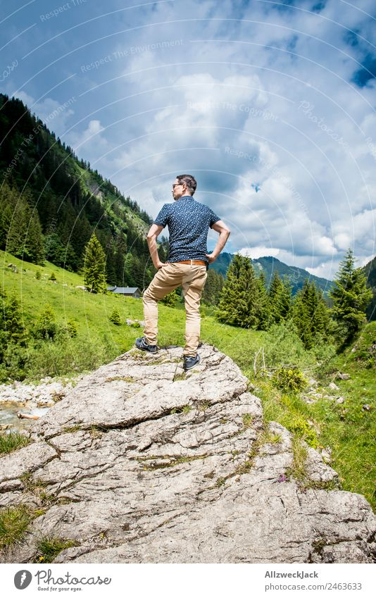 young man posing on a rock in front of a mountain panorama Day Beautiful weather Clouds Nature Green Tree Forest Mountain Idyll Vacation & Travel