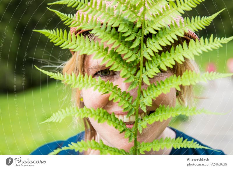 Portrait of a young woman with fern in her face Day Beautiful weather Nature Green Tree Forest Mountain Idyll Vacation & Travel Travel photography Hiking