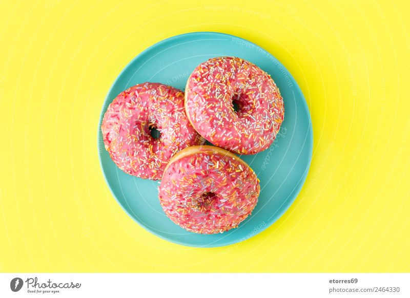 Pink frosted donut Roll Dessert Candy Good Sweet Yellow Donut Food Multicoloured Cake Baked goods Icing Hole Snack Tasty Bakery Fast food Round Sugar Blue