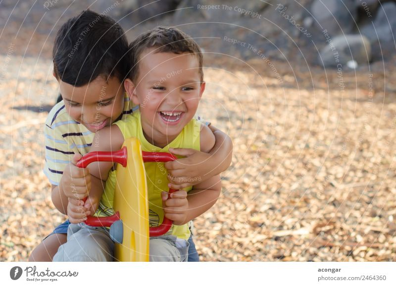 Two children laughing while playing in the playground. Lifestyle Joy Happy Playing Adventure Child Masculine Brothers and sisters Friendship Infancy 2