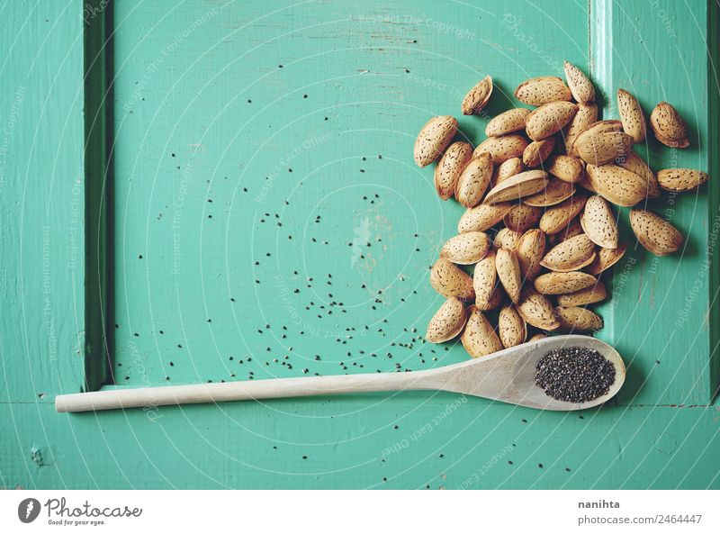 Wooden background with almonds and chia seeds Food Herbs and spices Almond Seeds Raw Nutrition Organic produce Vegetarian diet Diet Spoon Healthy Eating Simple