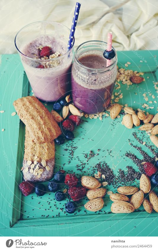 Healthy breakfast with smoothies, berries and grains Food Fruit Grain Dough Baked goods Raspberry Blueberry Almond chia Oat flakes Cookie Strawberry shake