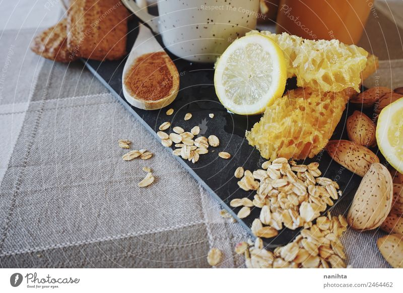 Healthy breakfast against common cold Food Fruit Grain Dough Baked goods Herbs and spices Cinnamon Lemon Almond Oats Oat flakes Honey Honeycomb Nutrition