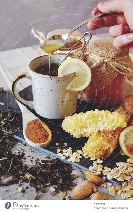Natural medicine against common cold Food Lemon Honey Honeycomb Cinnamon Oats Almond Nutrition Breakfast Organic produce Vegetarian diet Beverage Hot drink Tea