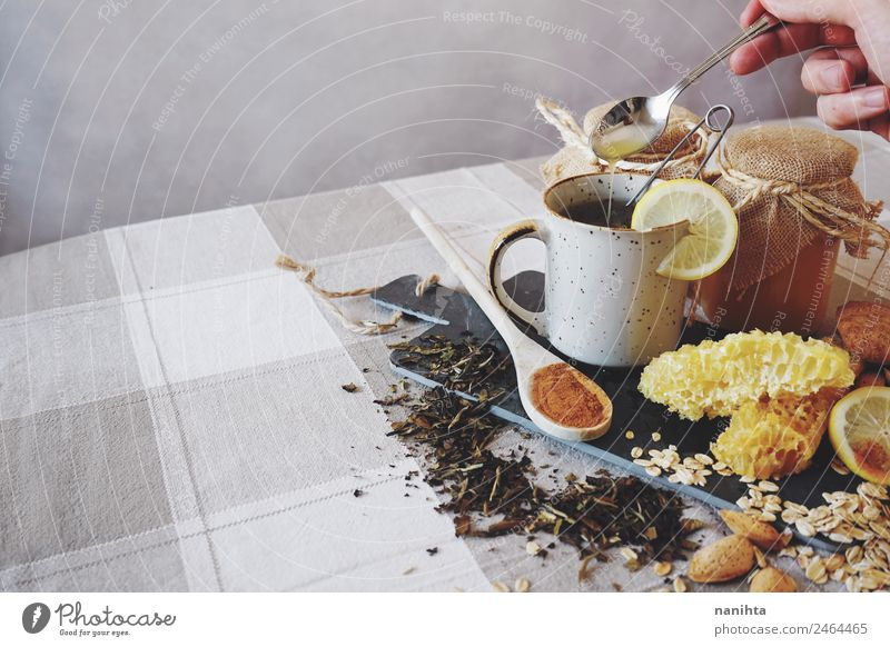 Healthy breakfast against common cold Grain Herbs and spices Almond Honey Honey-comb Cinnamon Lemon Oats Oat flakes Beverage Hot drink Tea Cup Spoon