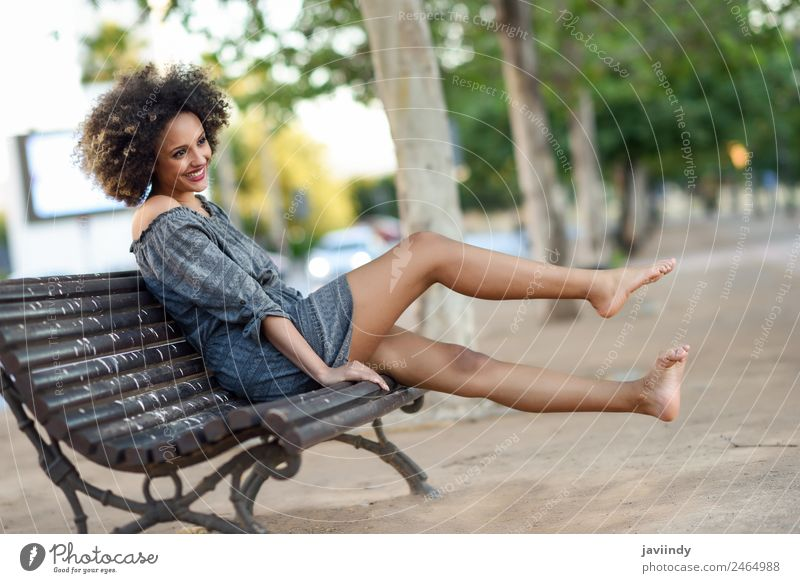 Young black woman with afro hairstyle sitting on a bench i Woman Human being Youth (Young adults) Young woman Beautiful Joy 18 - 30 years Black Face Street