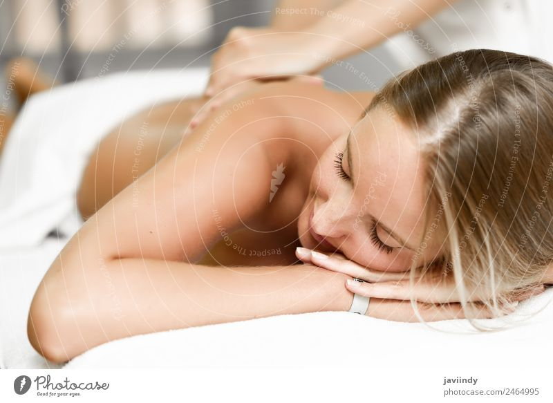 Young blond woman having massage in the spa salon Lifestyle Beautiful Body Health care Wellness Relaxation Spa Massage Human being Young woman