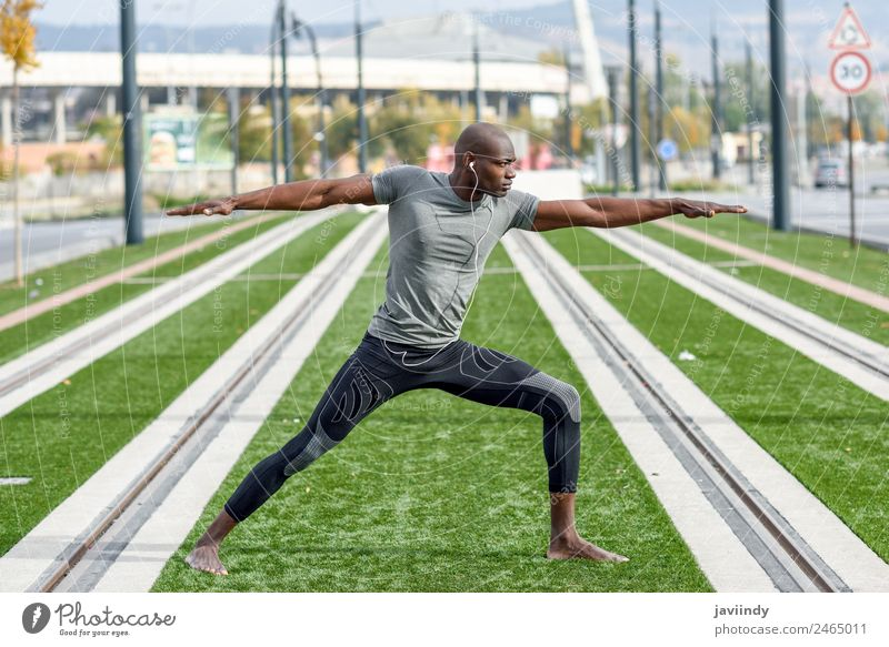 Black man practicing yoga in urban background. Lifestyle Sports Yoga Human being Masculine Young man Youth (Young adults) Man Adults 1 18 - 30 years Fitness