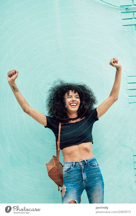 Funny black woman with afro hair raising arms outdoors. Woman Human being Youth (Young adults) Young woman Beautiful Joy 18 - 30 years Black Face Street Adults