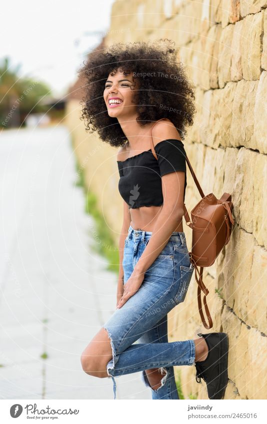 Happy mixed woman with afro hair laughing outdoors Woman Human being Youth (Young adults) Young woman Beautiful Joy 18 - 30 years Black Face Street Adults