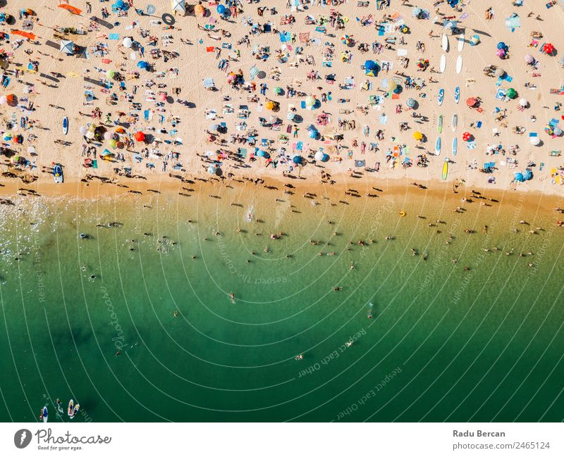 Aerial View From Flying Drone Of People Crowd Relaxing On Algarve Beach In Portugal Aircraft Vantage point Sand Background picture Water Above Ocean