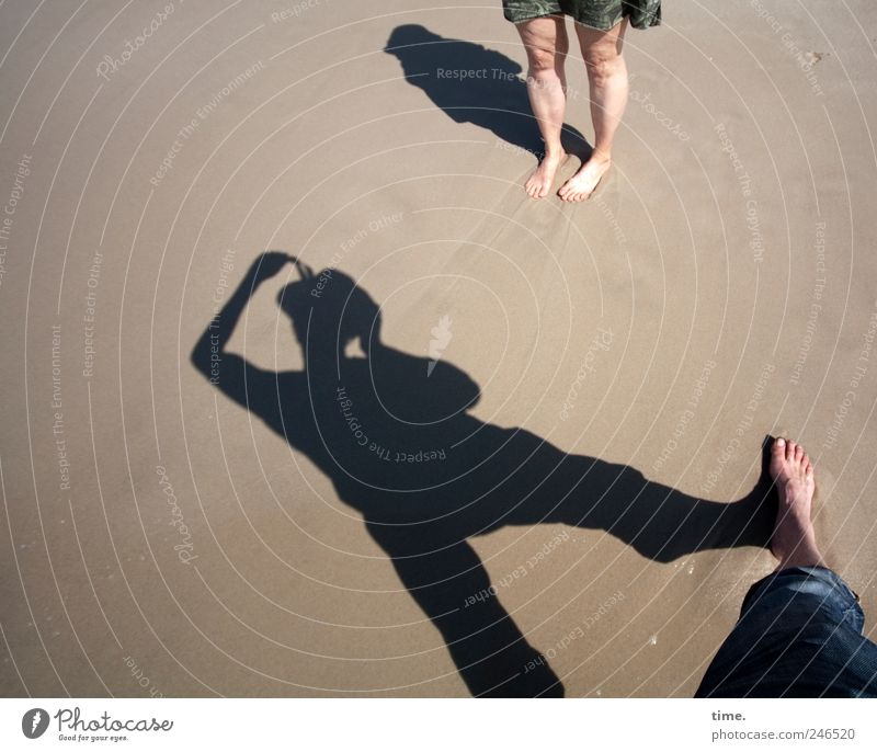 holiday photo Beach Human being Legs Feet 2 Sand Pants Dress Stand Take a photo Posture Colour photo Exterior shot Shadow Silhouette Deep depth of field