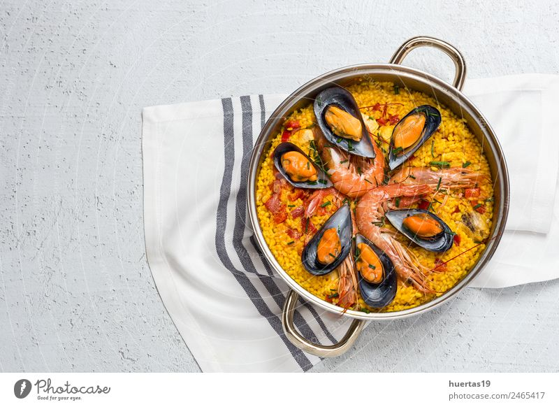 Traditional rice in paella Food Meat Fish Seafood Vegetable Lunch Diet Healthy Eating Delicious Sour Yellow Paella Rice Shellfish Chicken stew Spanish