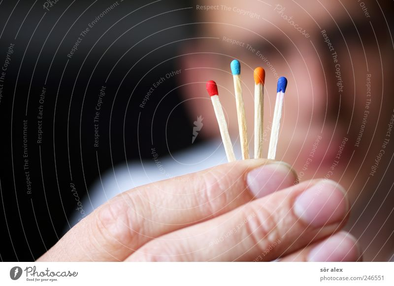 draw a match Masculine Man Adults Face Fingers Fingernail 1 Human being Match Wood To hold on Blue Red Perspective Risk Target Future Select Selection Decide