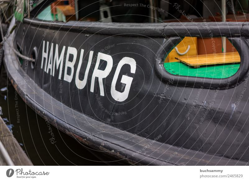 Close-up of a ship with the name of the Hanseatic City of Hamburg Port of Hamburg Navigation Hull Transport Trade Characteristic travel Town vacation