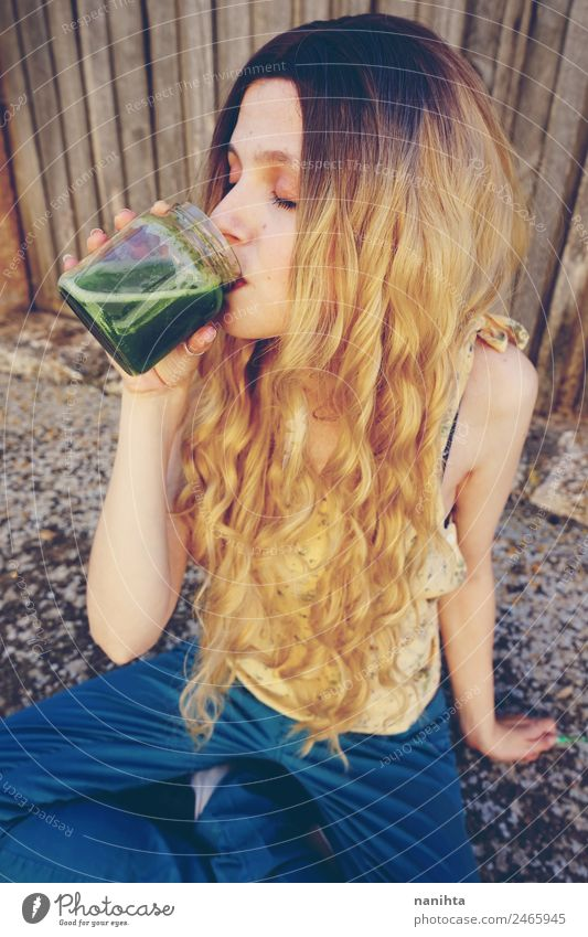 Young woman drinking a green smoothie Human being Youth (Young adults) Healthy Eating Beautiful 18 - 30 years Adults Lifestyle Natural Feminine Style