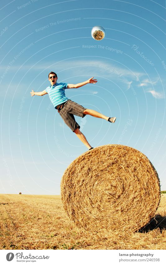 GRAVITY Joy Human being Masculine Young man Youth (Young adults) 1 18 - 30 years Adults Cloudless sky Sunlight Summer Field Bale of straw To fall Flying Playing