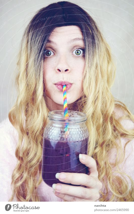 Beautiful young woman drinking a blueberry smoothie Fruit Nutrition Vegetarian diet Beverage Drinking Cold drink Juice Milkshake Lifestyle Style Healthy