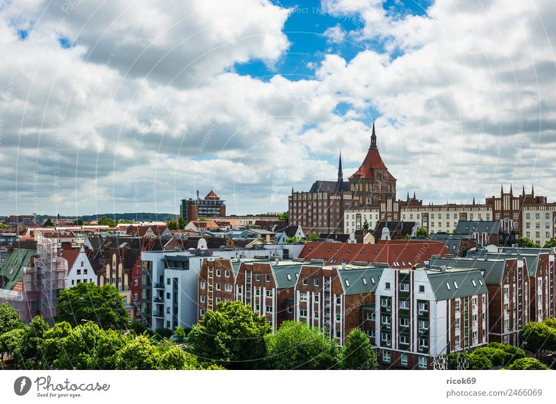 View of the Hanseatic city of Rostock Relaxation Vacation & Travel Tourism House (Residential Structure) Nature Clouds Town Building Watercraft Tradition Church