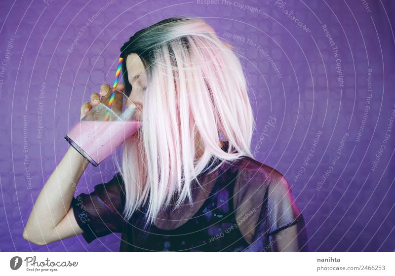Young woman with pink hair is drinking a milkshake Beverage Drinking Cold drink Juice Milk Milkshake Strawberry shake Lifestyle Style Design Hair and hairstyles