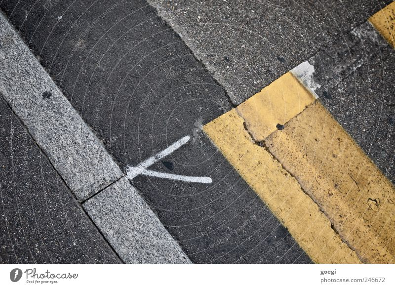 transitions Transport Traffic infrastructure Street Zebra crossing Pavement Asphalt Curbside Sign Road sign Line Arrow Old Yellow Gray White Chaos Change