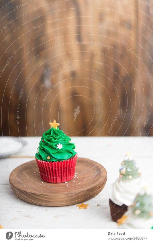cupcake christmas tree Dessert Decoration Table Feasts & Celebrations Birthday Wood Fresh Delicious Brown Pink White Colour background Baking Bakery Butter