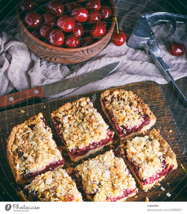 square pieces of cake crumble with cherry Fruit Dessert Candy Vegetarian diet Table Wood Fresh Delicious Above Brown Yellow Red Cherry Pie Baked goods tart food