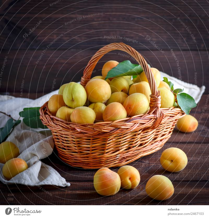 apricots in a brown wicker basket Fruit Nutrition Vegetarian diet Diet Table Nature Leaf Wood Fresh Delicious Natural Juicy Brown Yellow Colour Basket