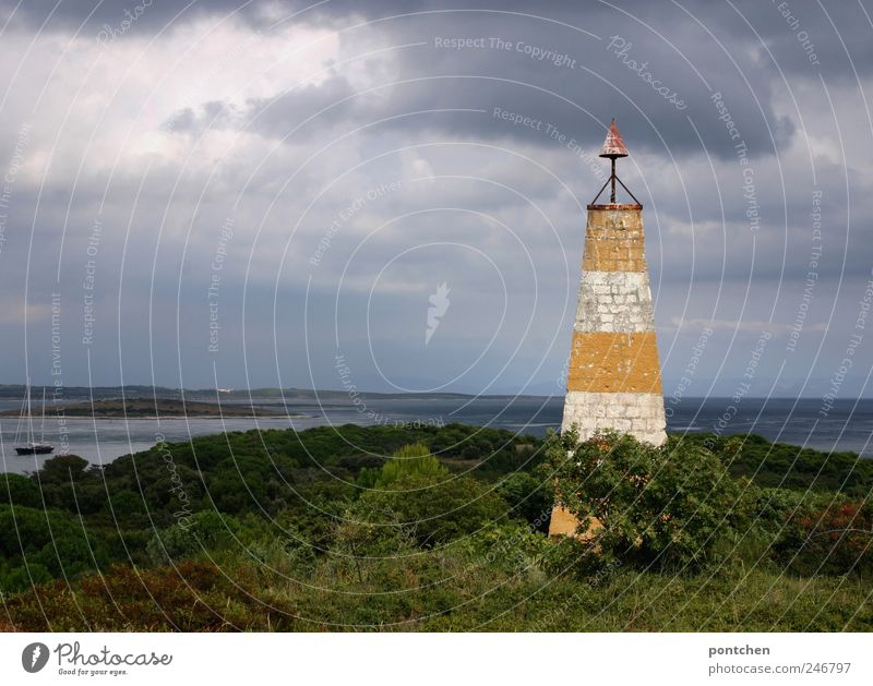Lighthouse in front of the sea in cloudy weather. Vacation & Travel Trip Sailing Nature Landscape Elements Sky Clouds Storm clouds Weather Bad weather bushes
