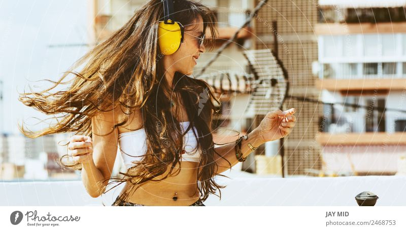 cheerful woman with long hair on headphones listens to music Lifestyle Style Joy Happy Beautiful Freedom Summer Music Dance Telephone Headset Human being Woman