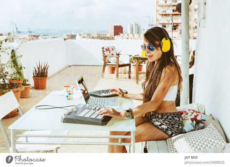 woman sitting with mixing table, producing music Lifestyle Summer Table Music Disc jockey Headset Computer Notebook Keyboard Technology Feminine Woman Adults