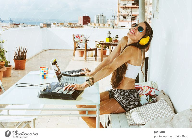 woman sitting with mixing table, producing music Lifestyle Summer Table Music Disc jockey Headset PDA Computer Notebook Keyboard Technology Feminine Woman