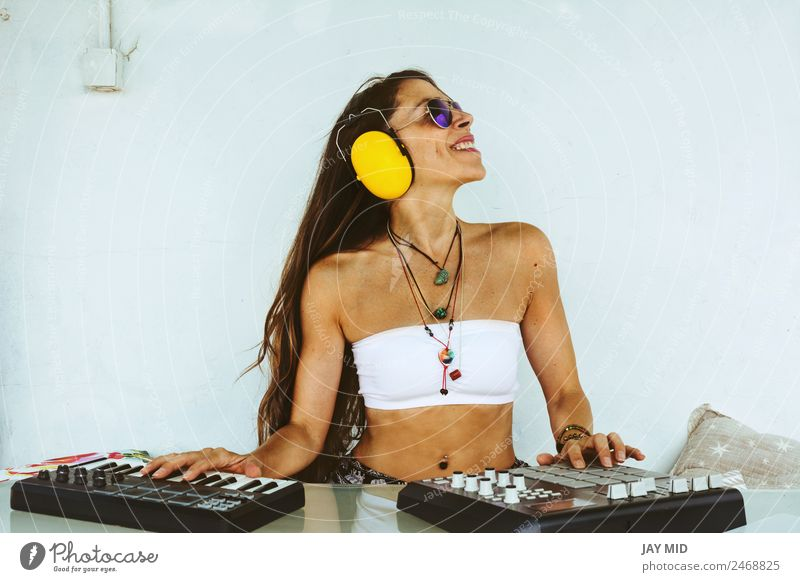 woman sitting with mixing table, producing music Woman Human being Summer Joy Adults Lifestyle Body Technology Music Smiling Creativity Table Spain Keyboard