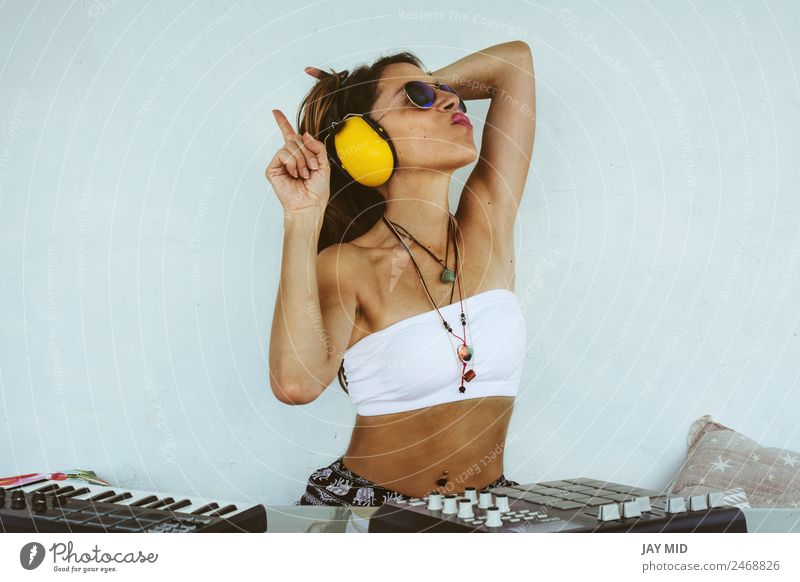 woman sitting with mixing table, producing music Woman Human being Summer Adults Lifestyle Feminine Body Technology Music Creativity To enjoy Table Spain