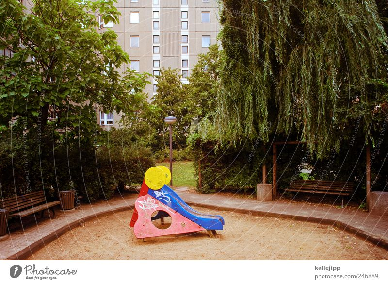 playground Leisure and hobbies Playing Tree Whimsical Playground Slide Sandpit High-rise Berlin Town Park Bench Colour photo Exterior shot Deserted Light Shadow