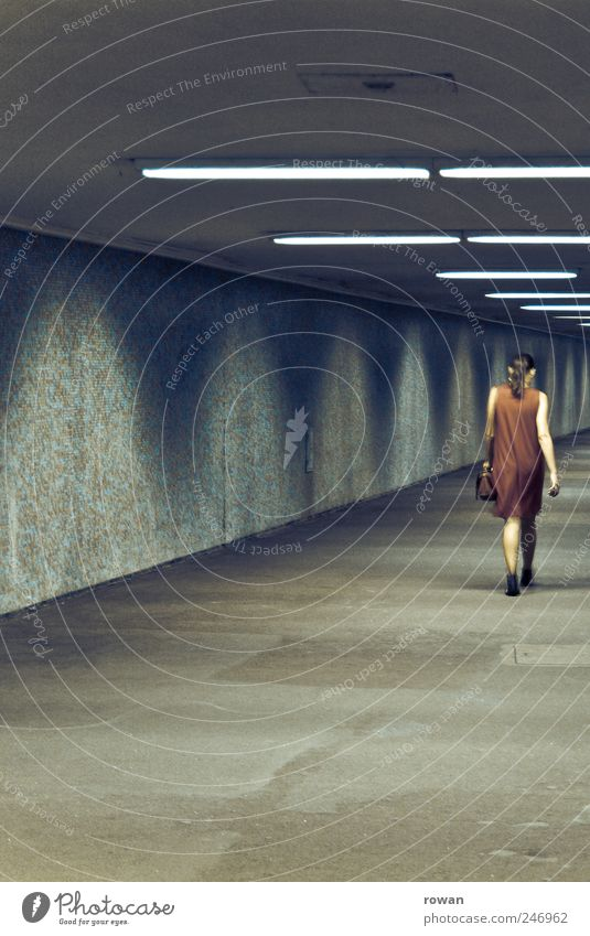 Lady in Red Feminine Young woman Youth (Young adults) 1 Human being Tunnel Underground Dress Bag Going Subsoil City life Dark Individual Neon light