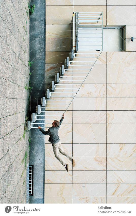 Human being Man Adults Wall (building) Architecture Wall (barrier) Stone Building Door Facade Stairs Masculine To hold on To fall Climbing Upward