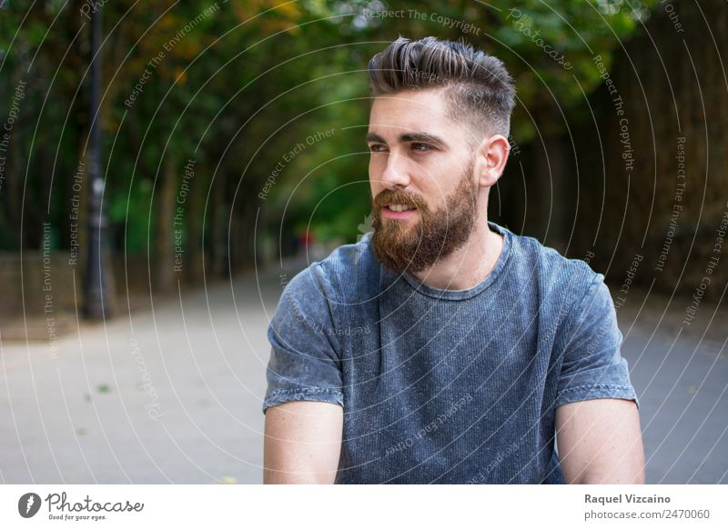 Man sitting outdoors in spring Human being Masculine Young man Youth (Young adults) Head Face Bottom 1 18 - 30 years Adults Park T-shirt Blonde Beard Catch