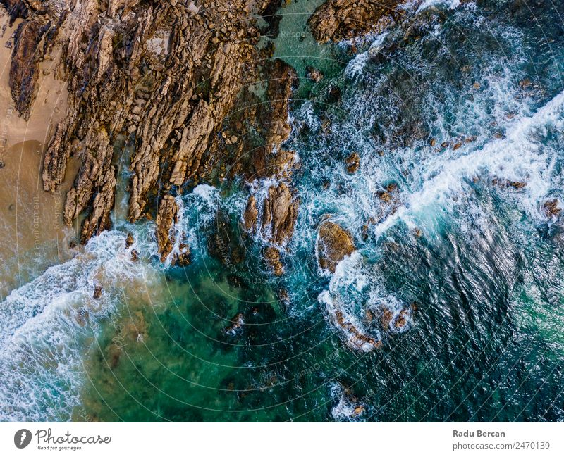 Aerial Drone View Of Dramatic Ocean Waves Crushing On Rocky Landscape Movement slow Aircraft rock beach Beach Abstract Vantage point Top Water Nature Beautiful