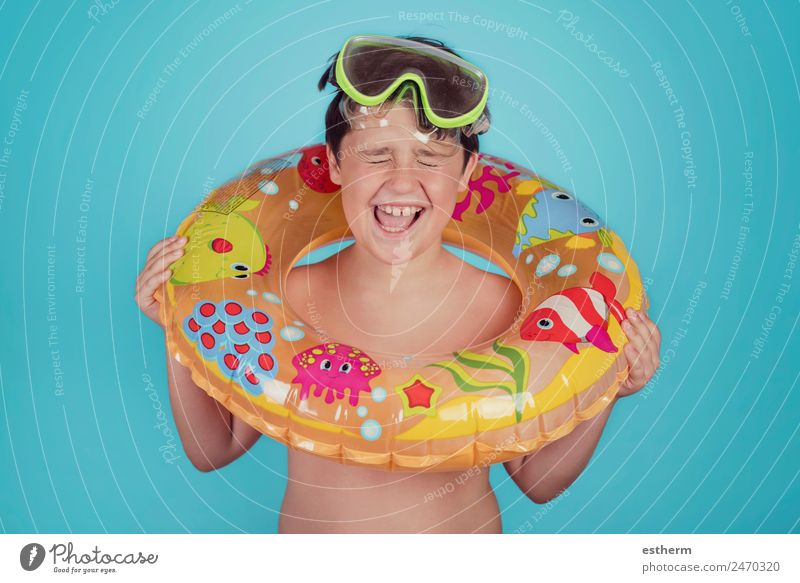 happy child smiling with float ring Lifestyle Joy Swimming pool Leisure and hobbies Vacation & Travel Trip Summer Sun Beach Ocean Sports Dive Human being