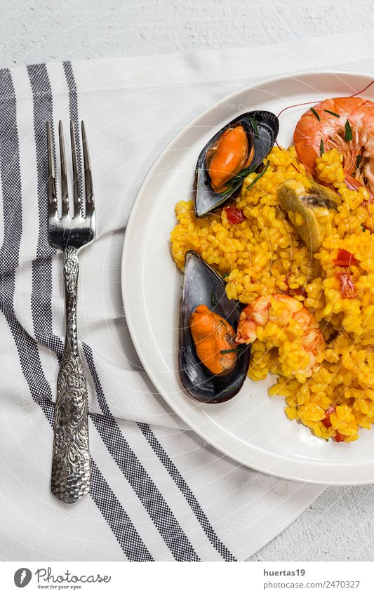 Traditional rice in paella with fish and meat Food Meat Seafood Vegetable Diet Plate Healthy Eating Sour Paella Rice Shellfish Chicken stew Spanish