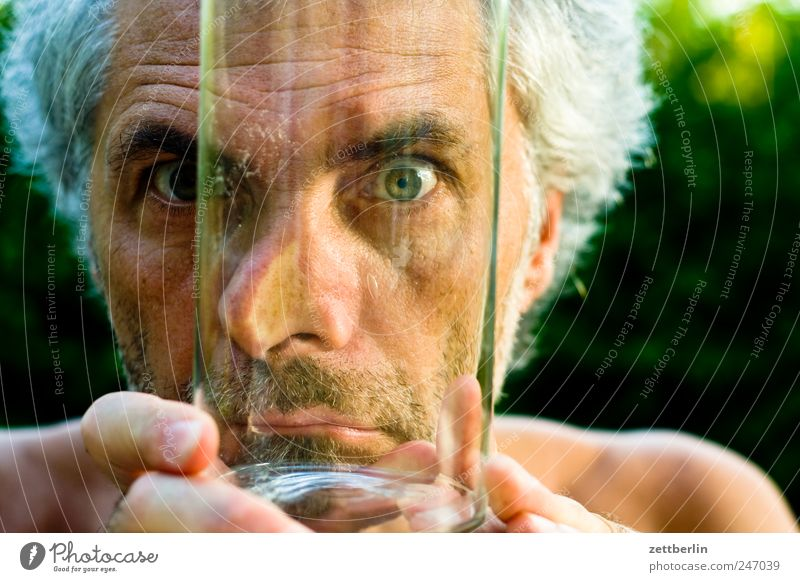 transparency Garden Masculine Man Adults Face Eyes Nose Mouth 45 - 60 years Plant Glass Looking Growth Garden plot Gaze Vista Direct Colour photo Exterior shot
