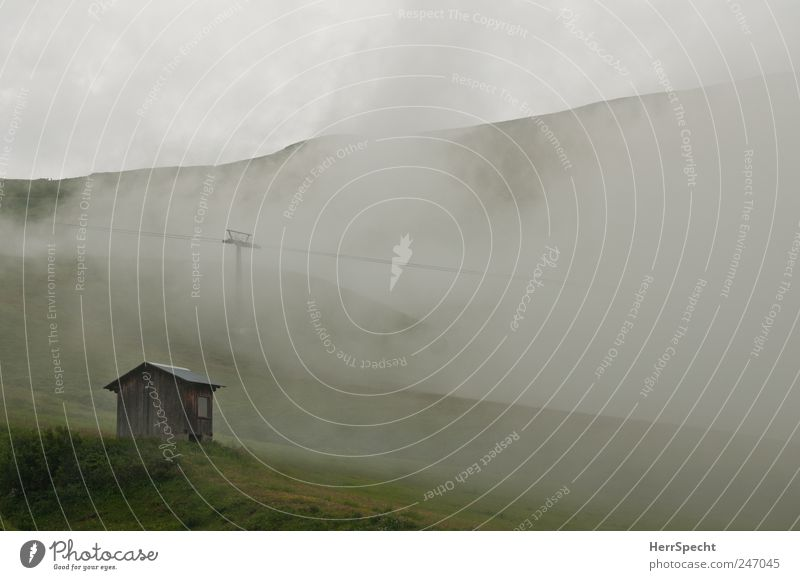 hut weather Environment Nature Landscape Bad weather Fog Alps Mountain Hut Threat Cold Gray Green Loneliness Apocalyptic sentiment Alpine pasture Cable car Hill