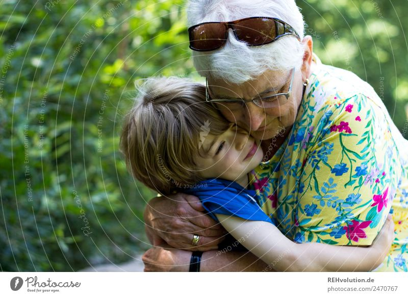 Grandma cuddles up with her grandson Lifestyle Human being Feminine Child Boy (child) Female senior Woman Grandmother Family & Relations Infancy Senior citizen
