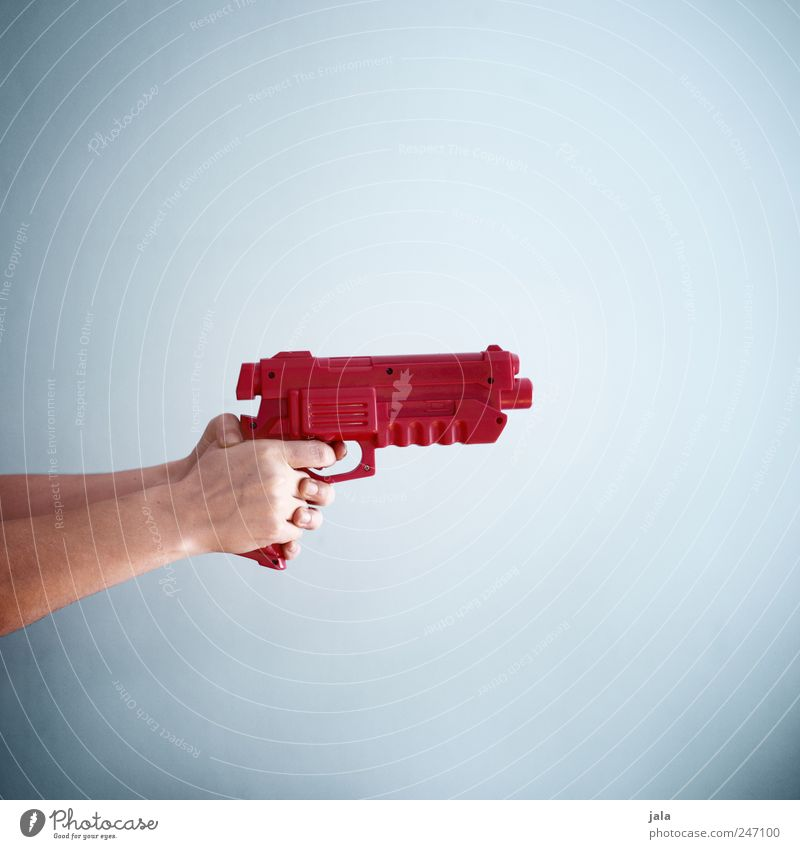 Bang! Playing Human being Hand Weapon Gunpoint Aggression Blue Red Force Hatred Colour photo Interior shot Copy Space right Copy Space top Copy Space bottom